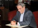 Representante del BID en Uruguay, Juan Taccone, durante la firma