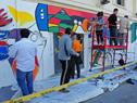 Pintado de mural en la fachada del Ministerio de Trabajo y Seguridad Social