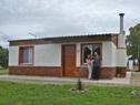Beneficiarios en su nueva vivienda de Mevir en Tala, Canelones