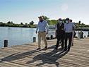 Ministro Luis Alberto Heber junto a autoridades del MTOP en recorrida por el puerto de Carmelo